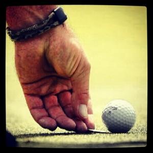 golf marcar bola green