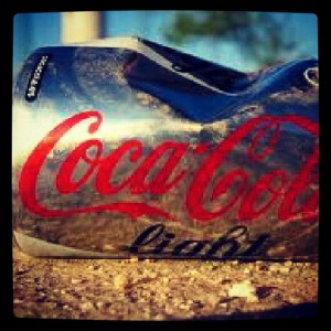 lata cocacola obstaculo golf